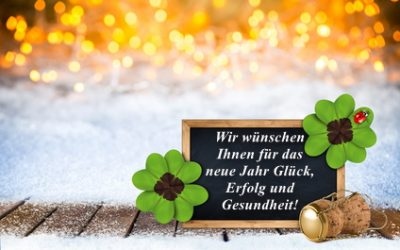 2017 Silvester new years eve bokeh background with champagne cork empty blackboard decorated with four leaf clover and ladybug
